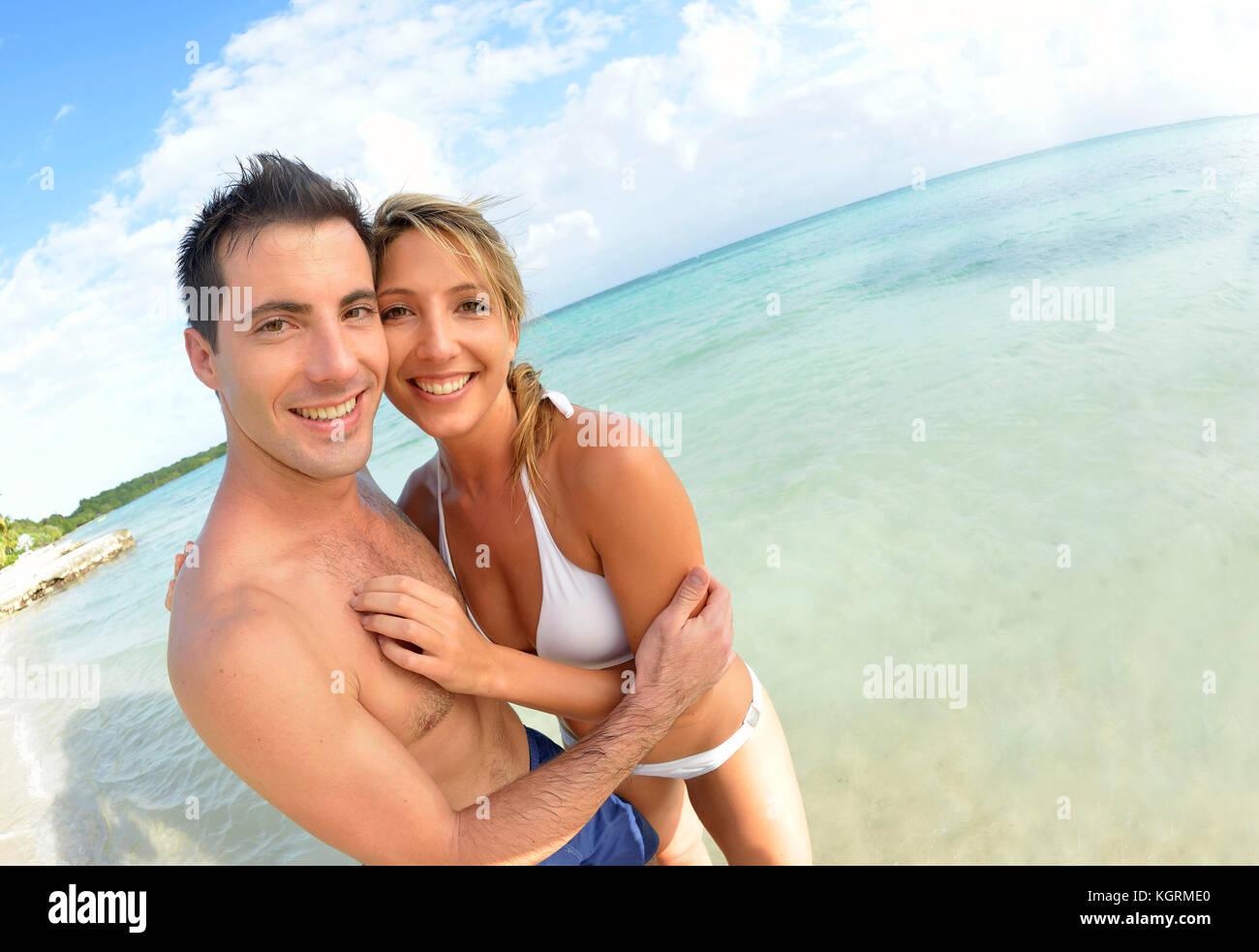 Couple having fun at the beach - Stock Image