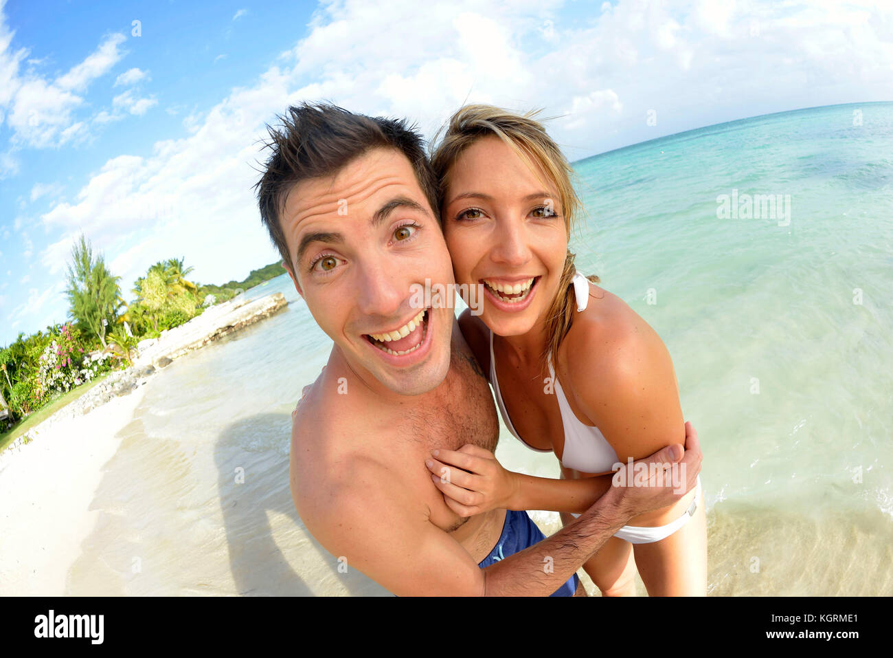 Couple having fun at the beach - Stock Image