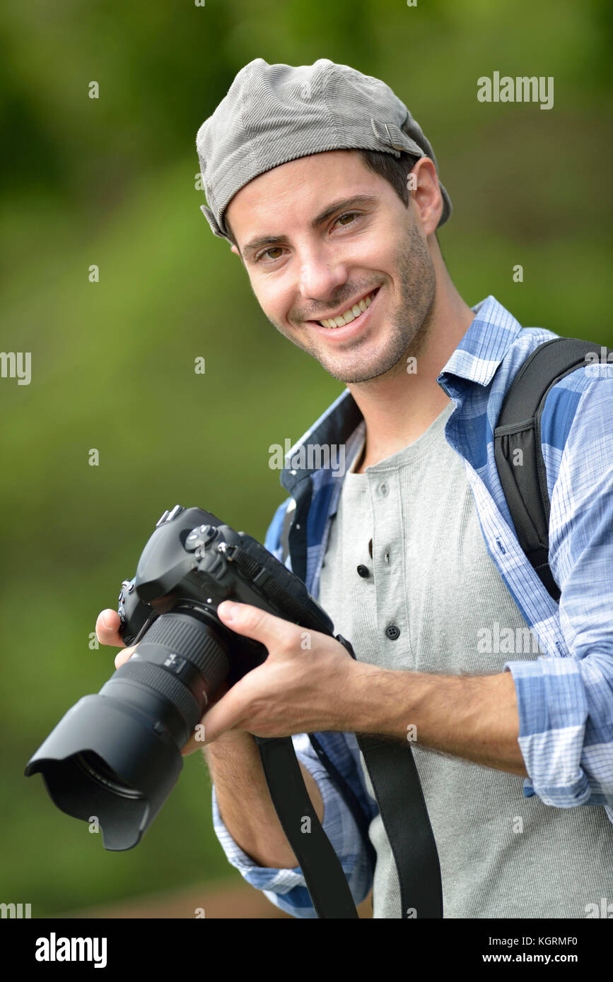Photo reporter on a shooting day - Stock Image