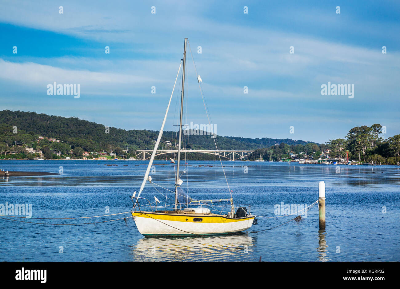 Australia, New South Wales, Central Coast, Woy Woy,  sailing boat moord at Brisbane Water with view of the Rip Bridge - Stock Image