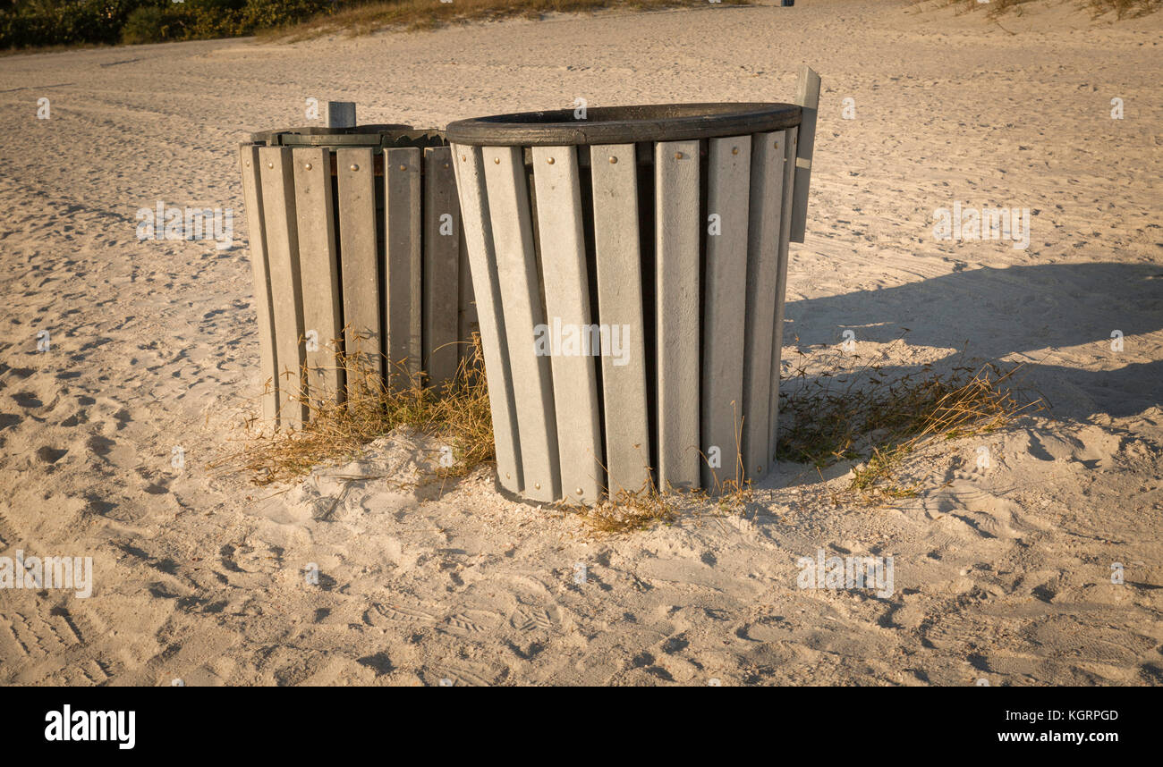 Plastic trash cans on a beach in Florida - Stock Image