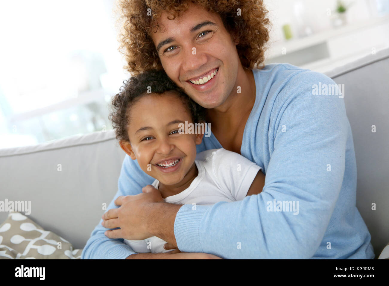 Father and child having fun together at home - Stock Image