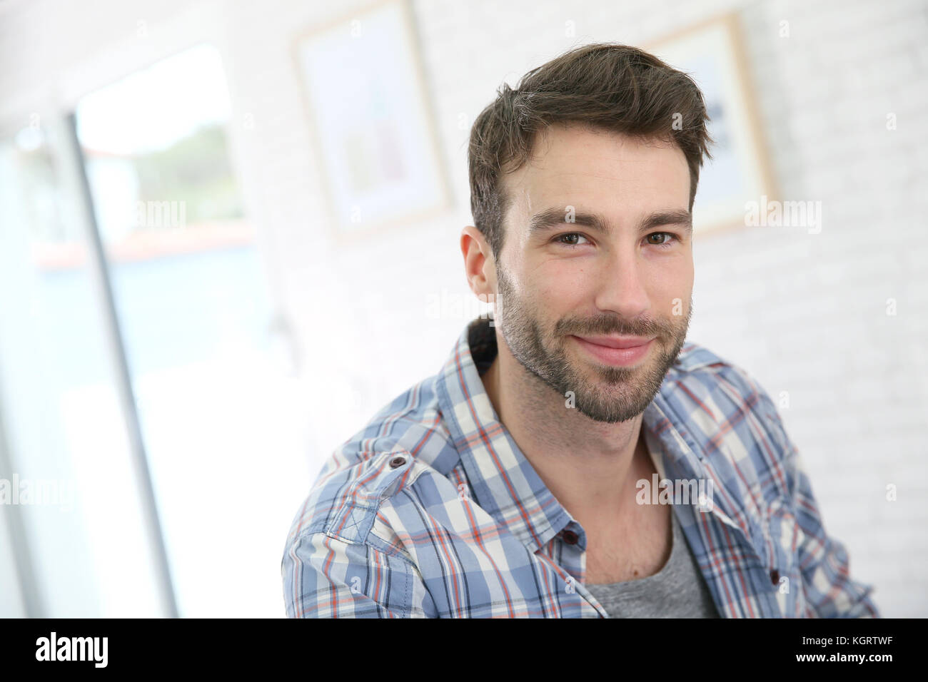 Portrait of cheerful 30-year-old man - Stock Image