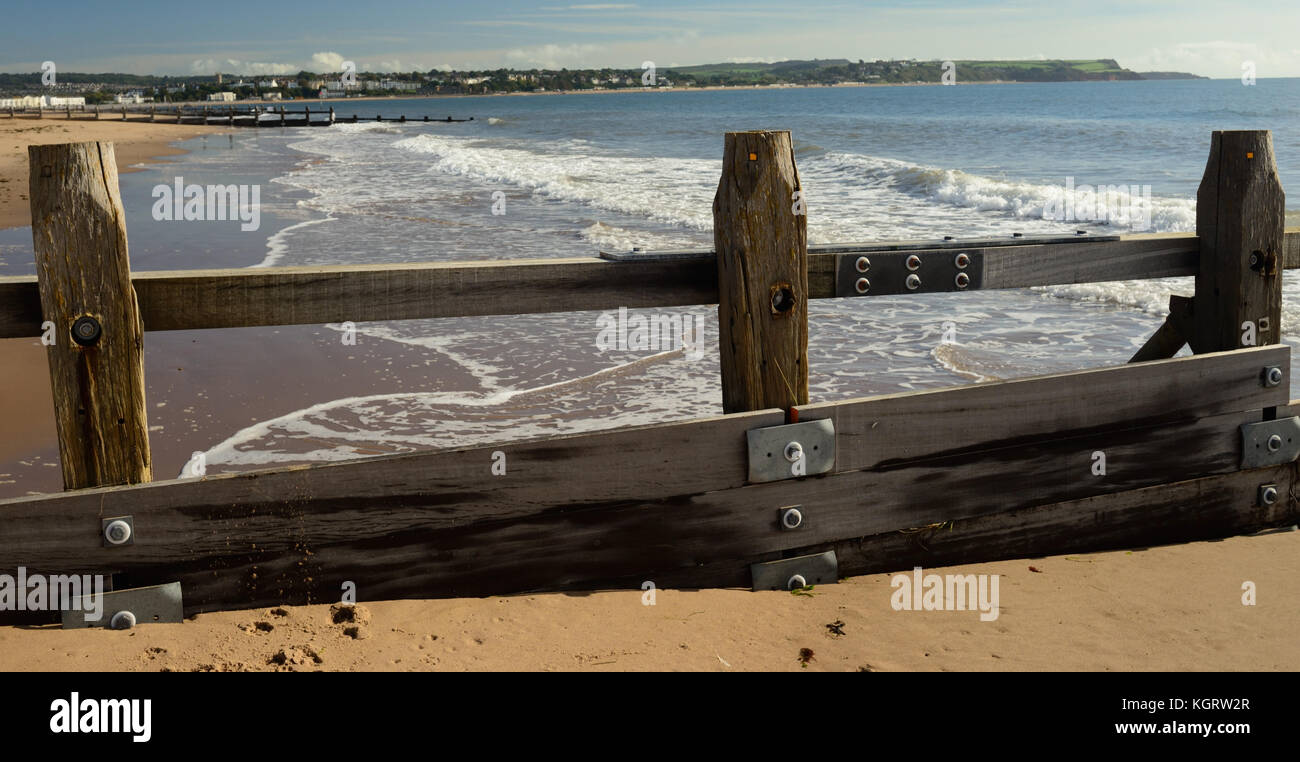 Groynes at Dawlish Warren, looking towards Exmouth. - Stock Image