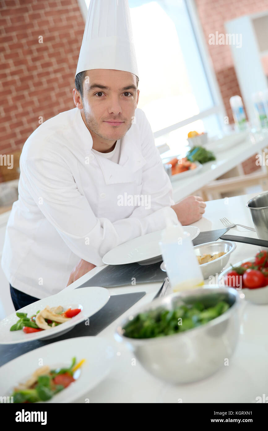 Portrait of chef in professional kitchen Stock Photo ...