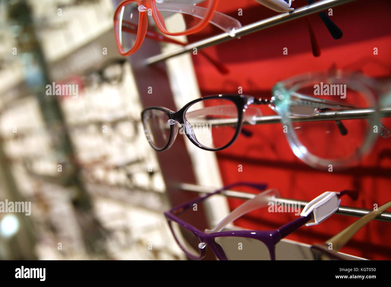 Eyeglasses set on a display unit in shop - Stock Image