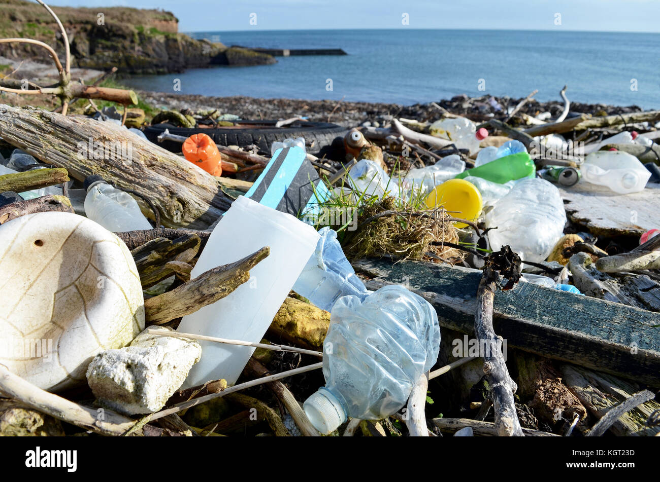litter washed up on a beach in county cork, ireland. - Stock Image