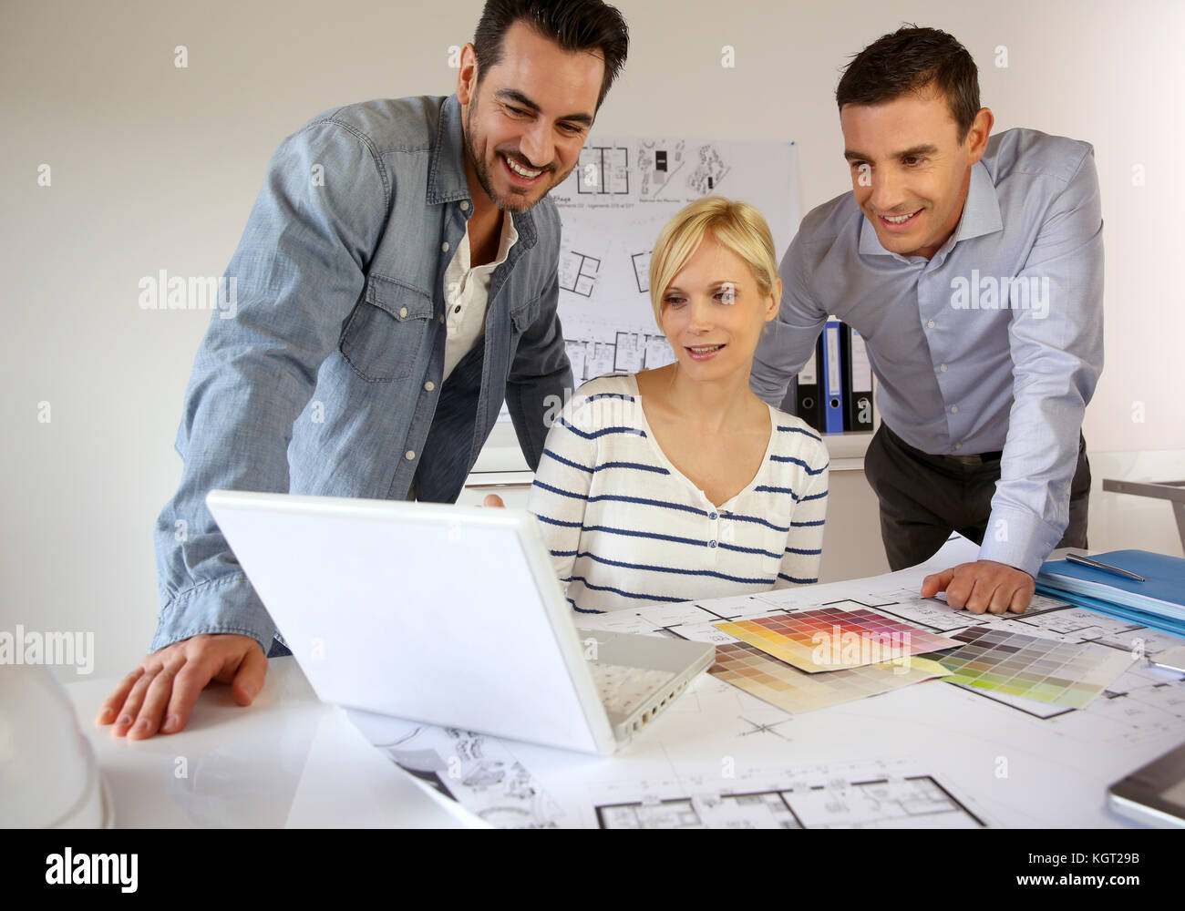 Team of architects presenting construction project - Stock Image