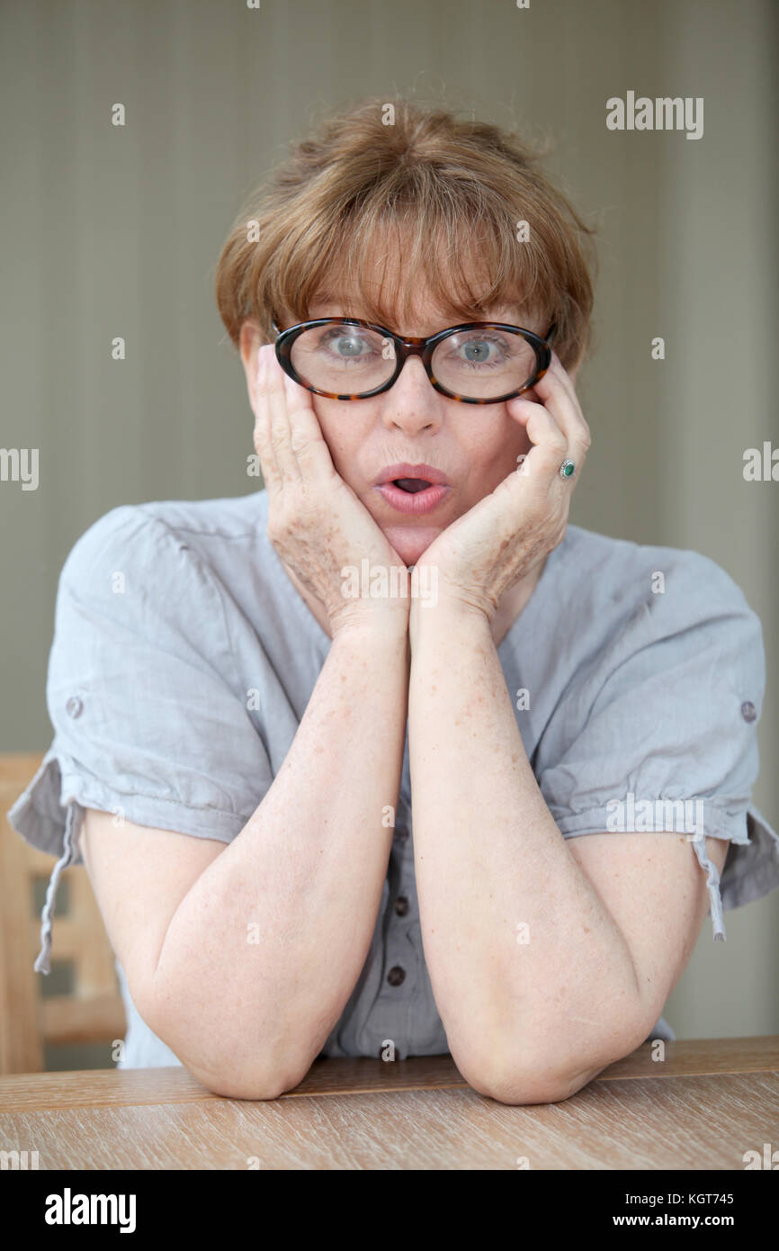 Senior woman with surprised look Stock Photo
