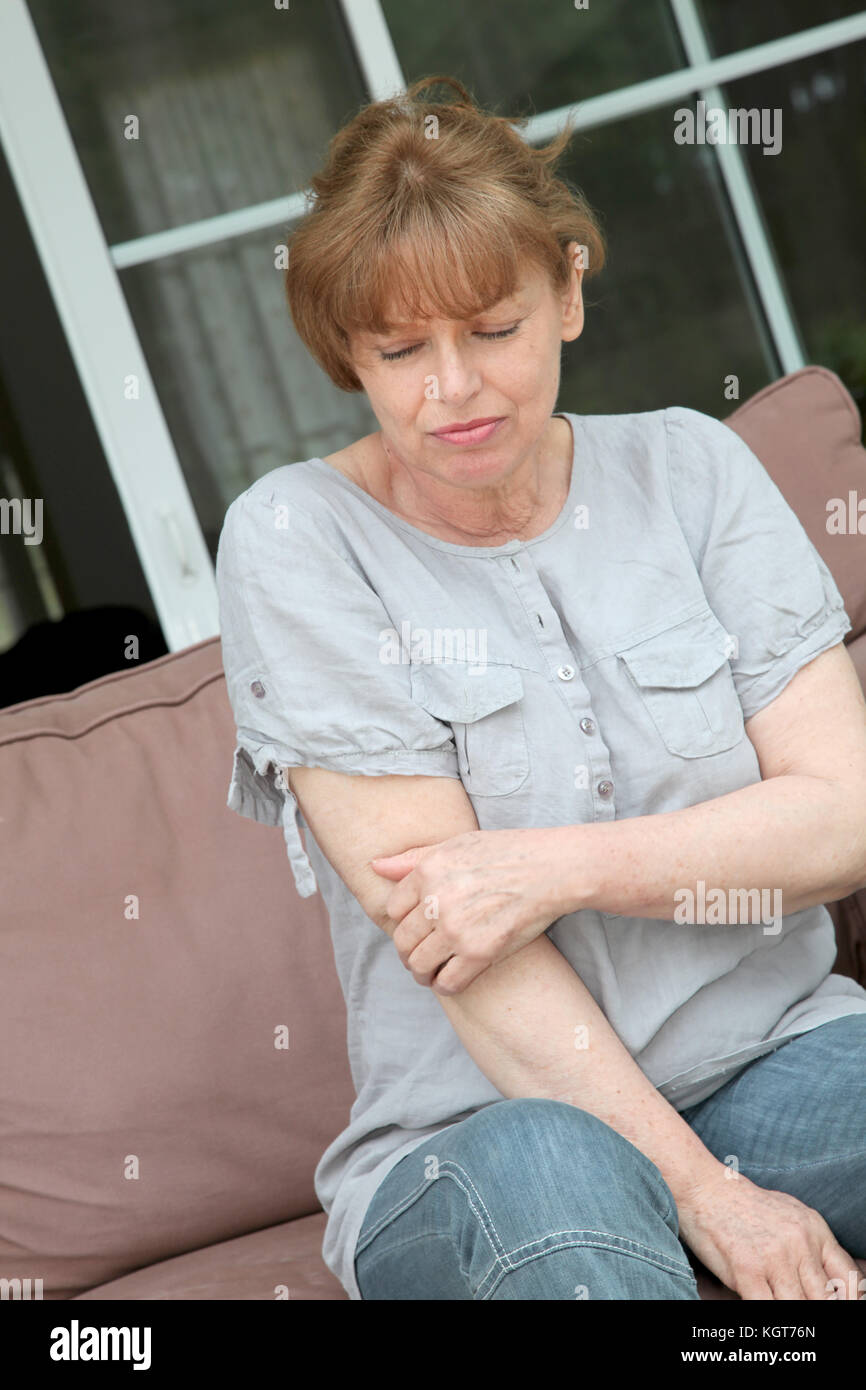 Senior woman with osteoarthritis pain - Stock Image