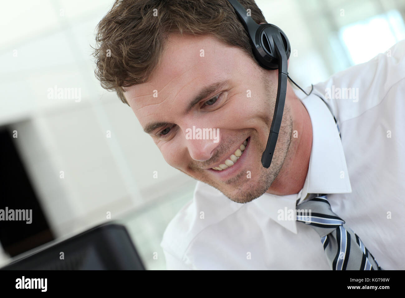 Portrait of salesman with headset on Stock Photo