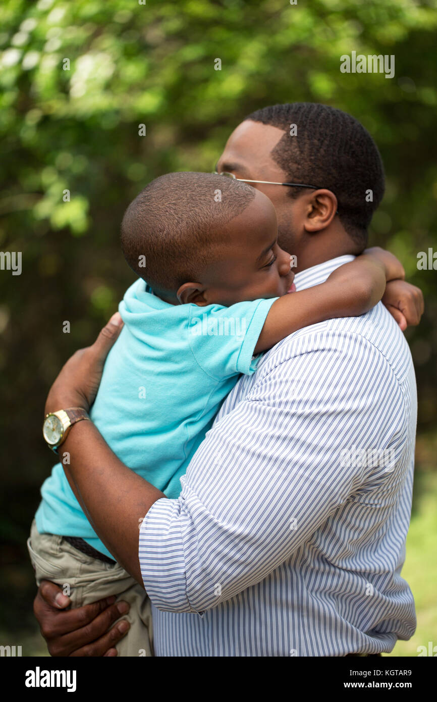 Father hugging his his son. - Stock Image