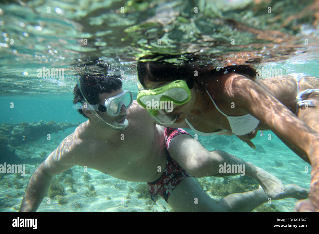 Couple snorkeling in Caribbean waters - Stock Image