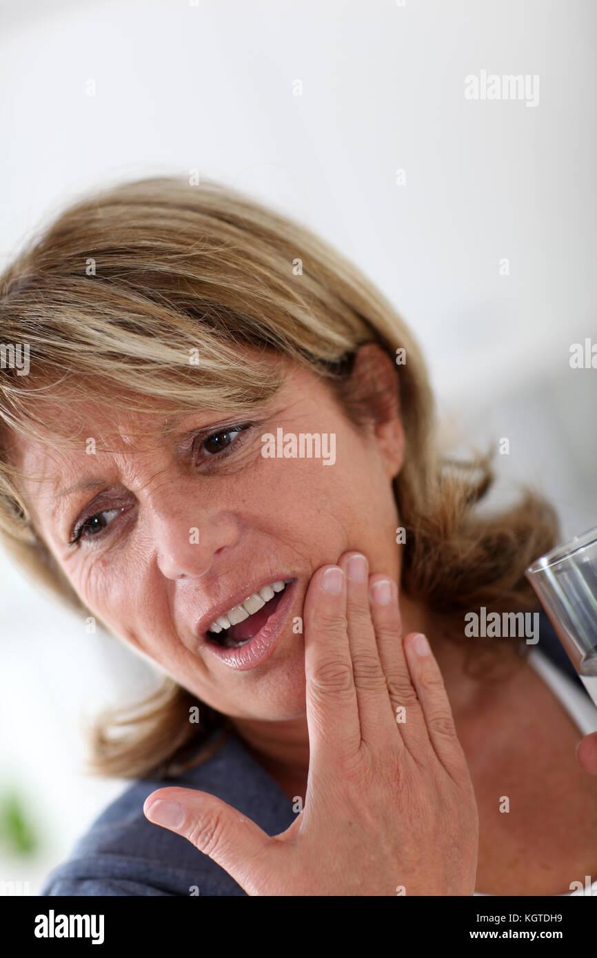 Closeup of senior woman having toothache - Stock Image