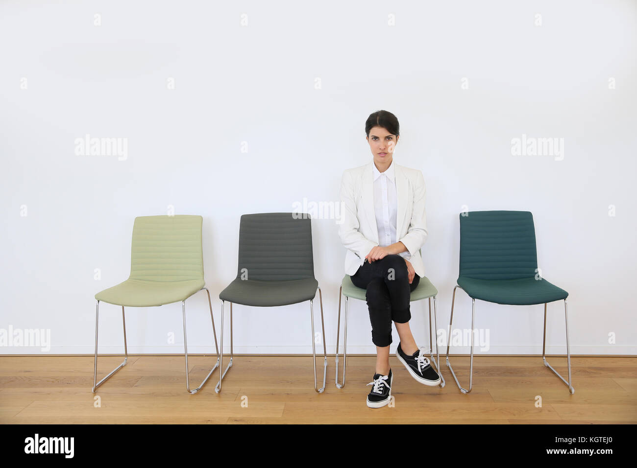 Job applicant sitting in waiting room, interview day - Stock Image