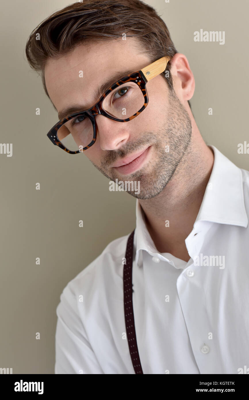 Stylish guy with eyeglasses and suspenders - Stock Image