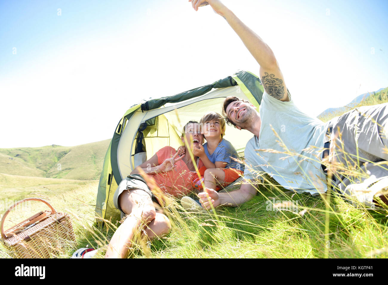 Family taking selfie picture while camping - Stock Image