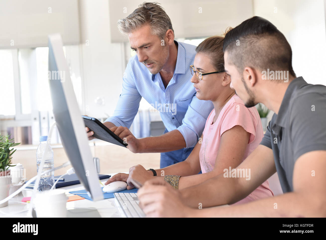 Students in design training course using tablet - Stock Image