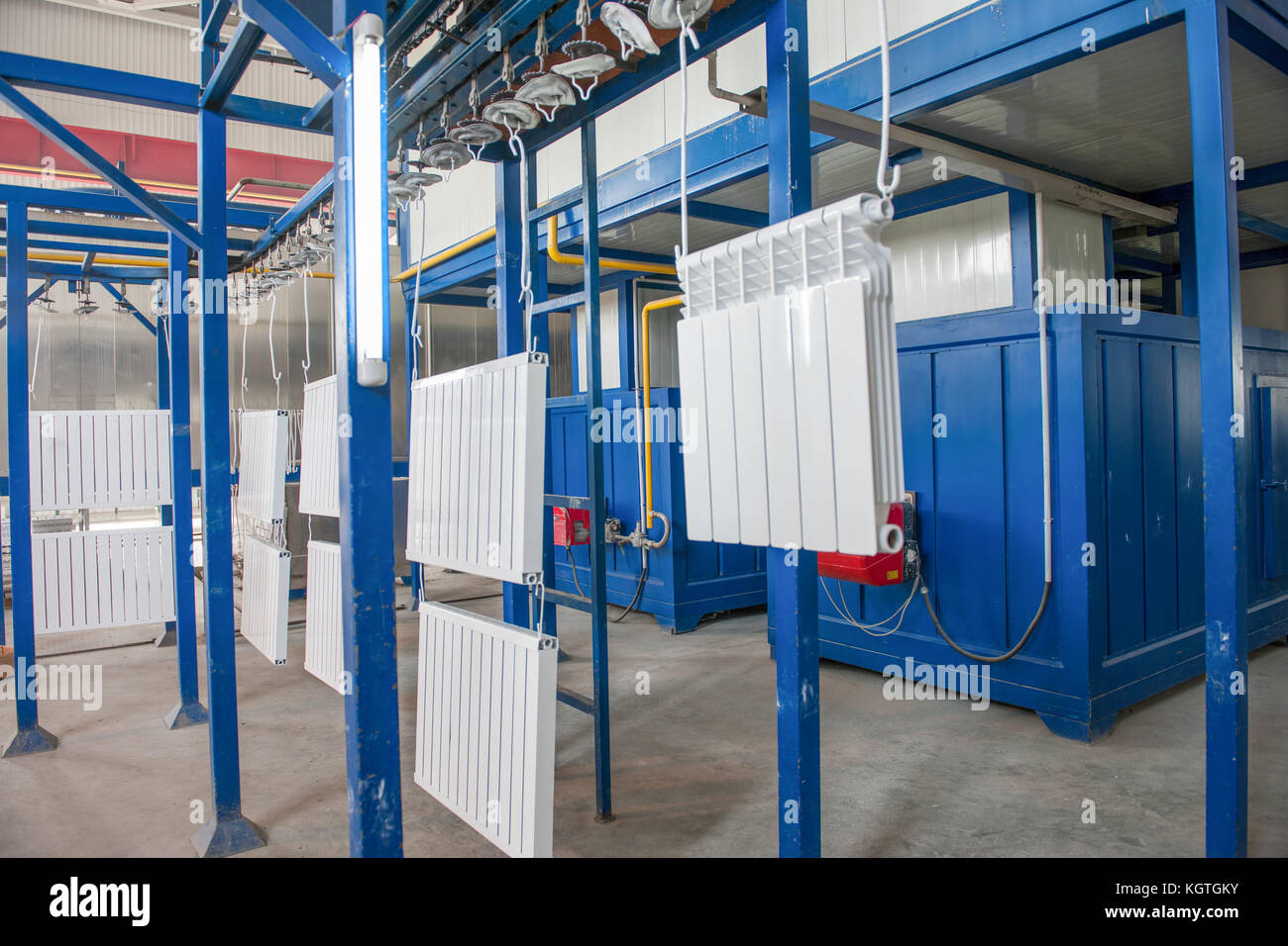 workshop for assembling and painting household heating radiators. conveyor line painting and drying of household Stock Photo