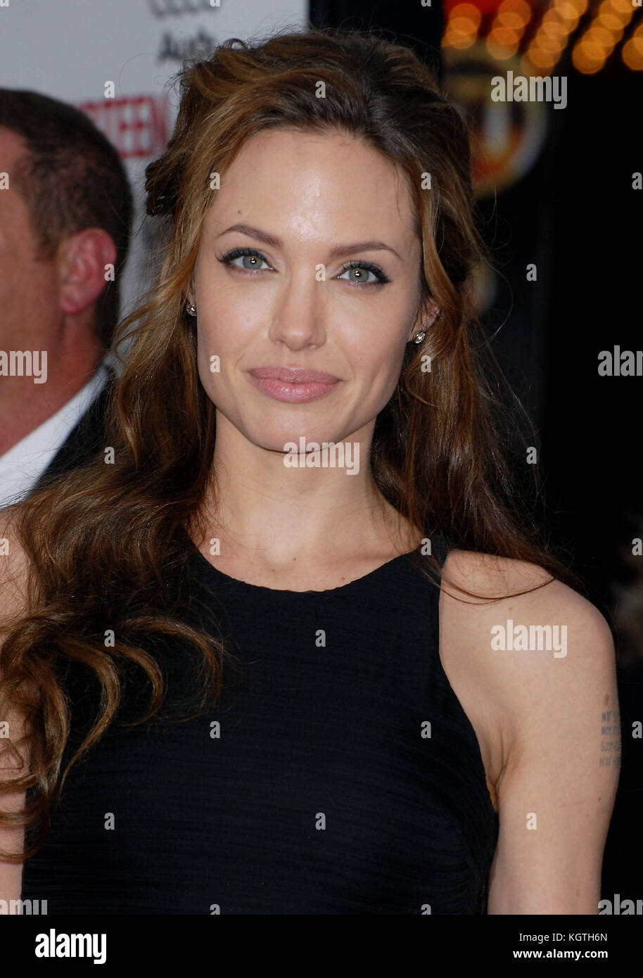 arriving at the OCEAN 13 Premiere at the Chinese Theatre in Los Angeles.  headshot full length 3/4 eye contact smileAngelina - Stock Image