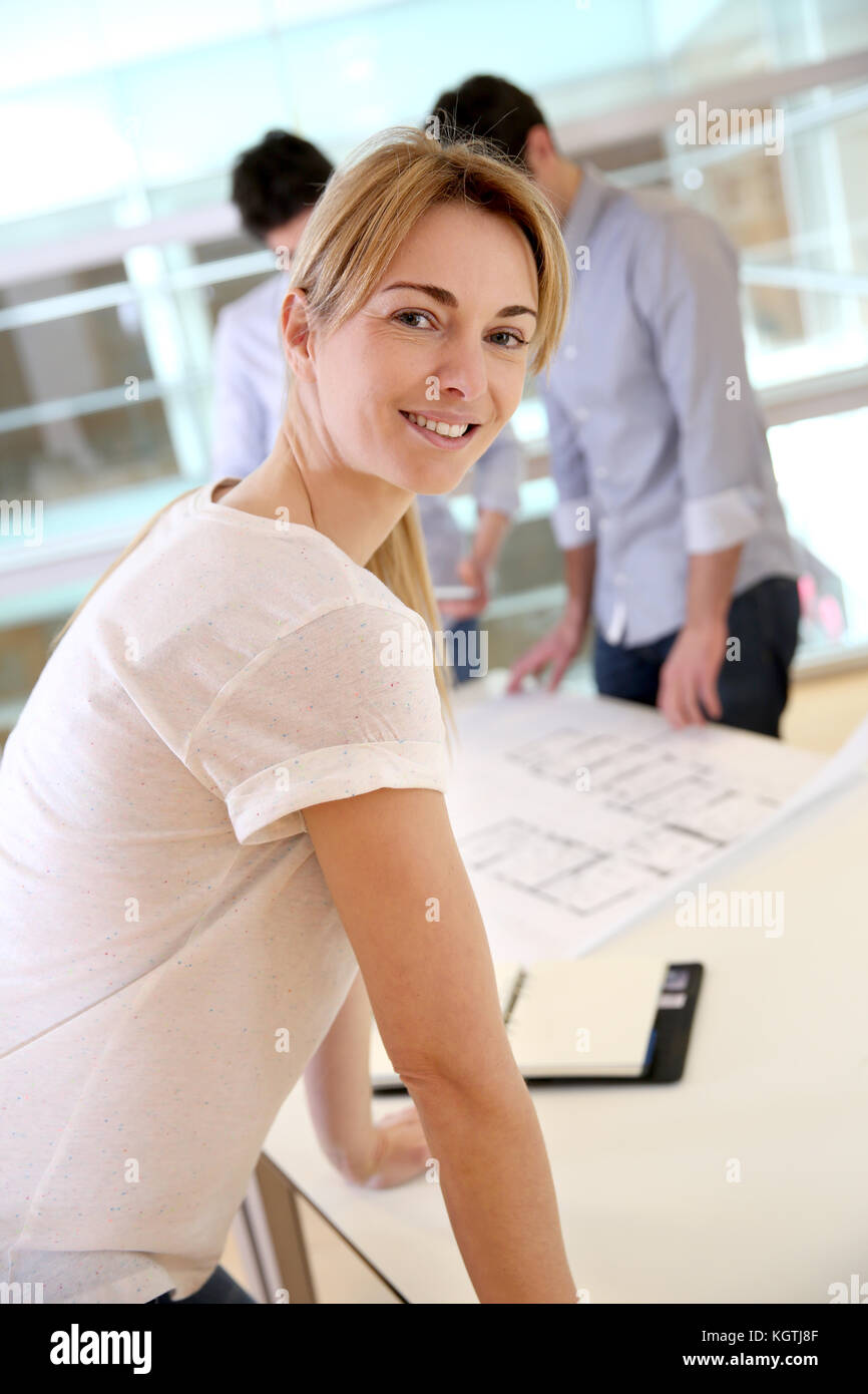 Cheerful architect woman looking satisfied - Stock Image