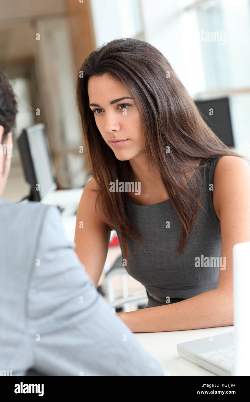 Young woman being interviewed for a job position Stock Photo