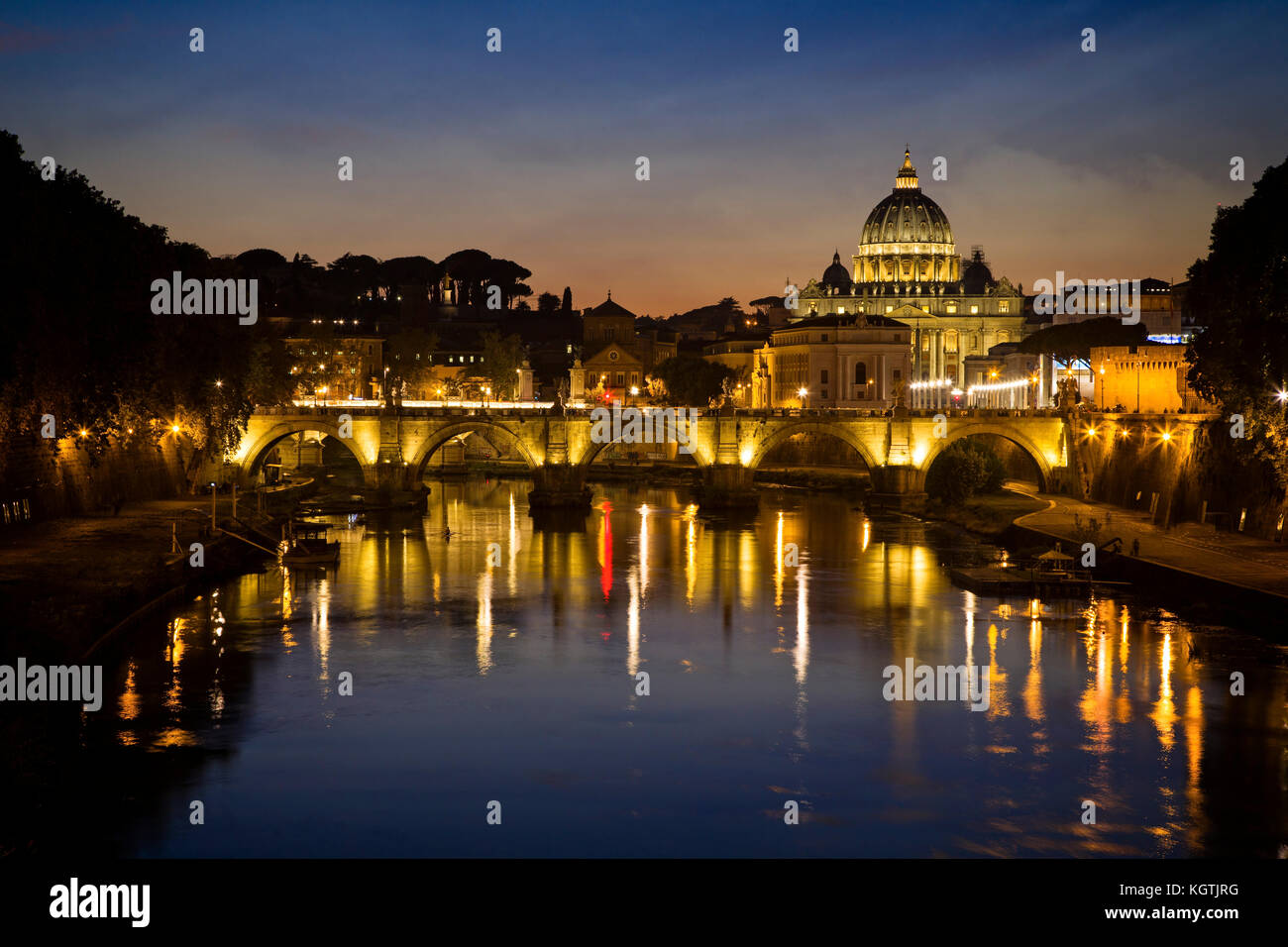 St. Peters Basilica, Ponte Vittorio Emanuele II, and the Tiber River in Rome, Italy. - Stock Image