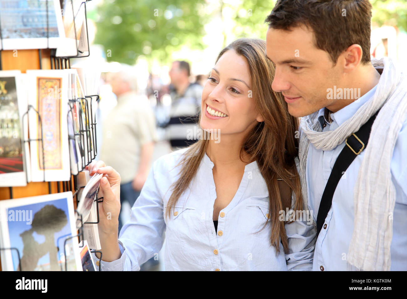 Couple in Madrid looking at postcards - Stock Image