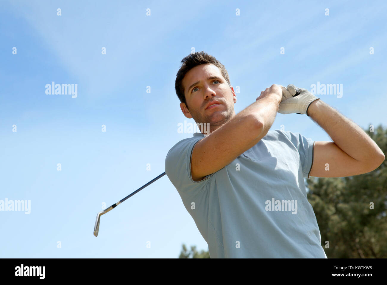Portrait of golfer playing in summertime - Stock Image
