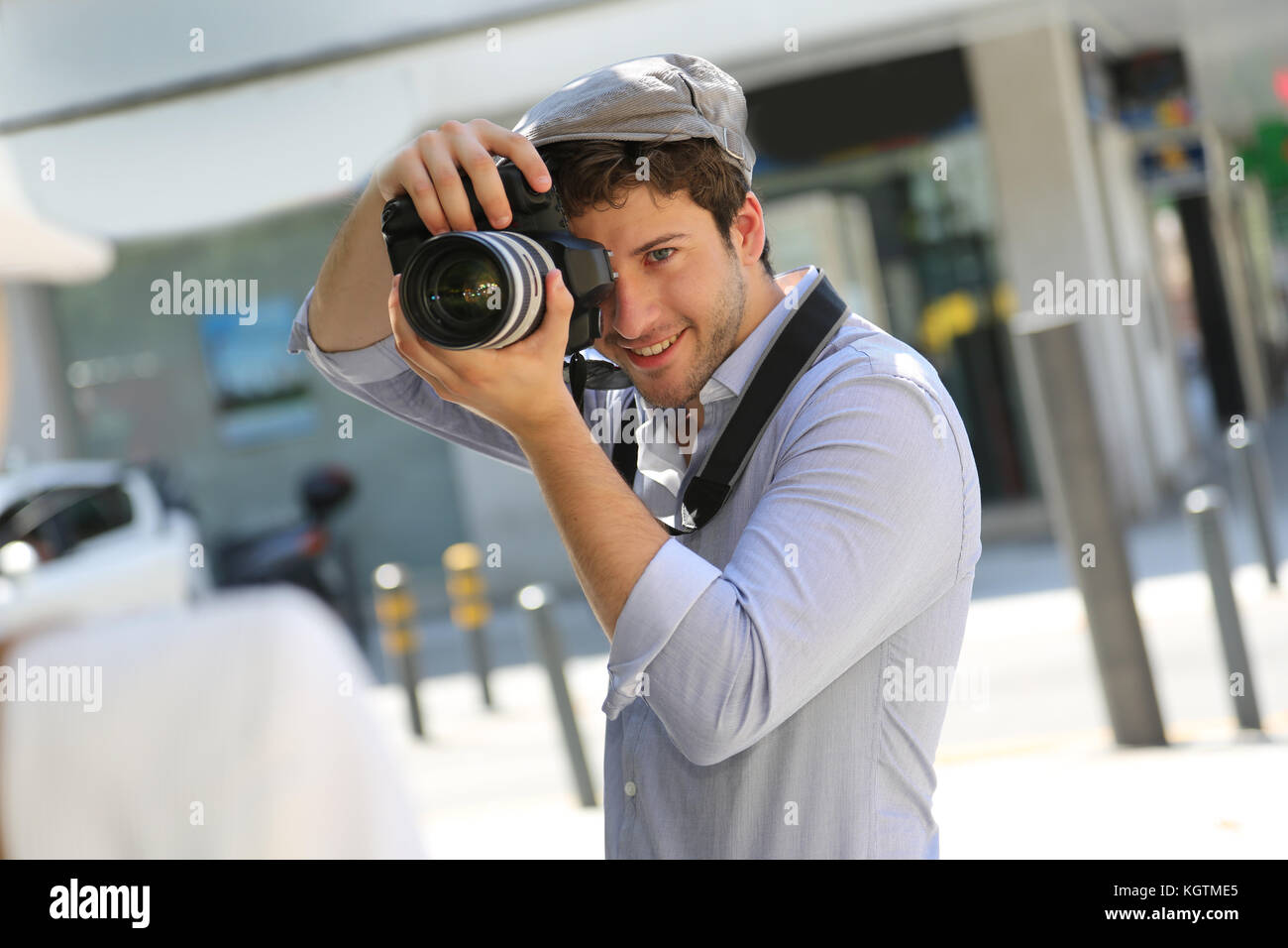 Photographer taking picture of woman model - Stock Image