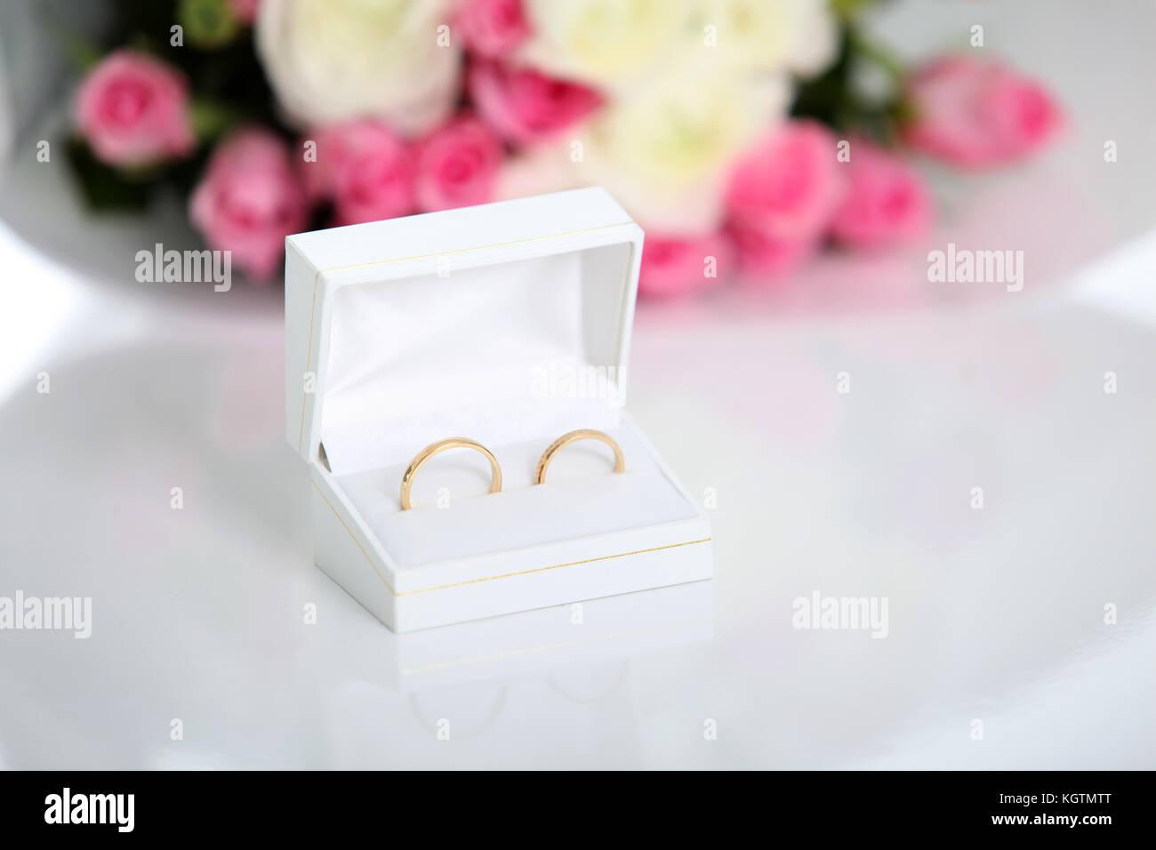 Closeup on wedding rings in jewel box - Stock Image