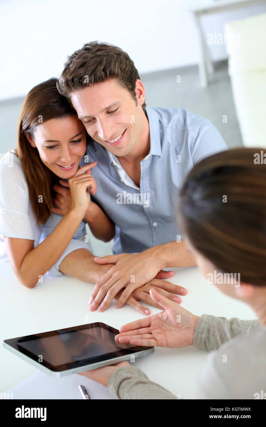 Young couple meeting financial adviser - Stock Image