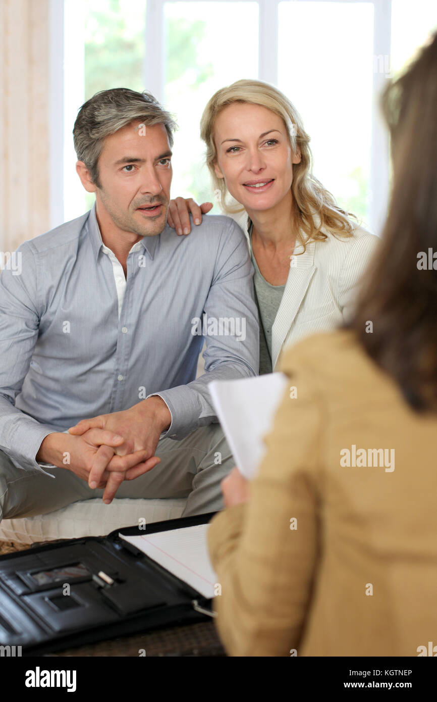 Couple meeting advisor at home - Stock Image