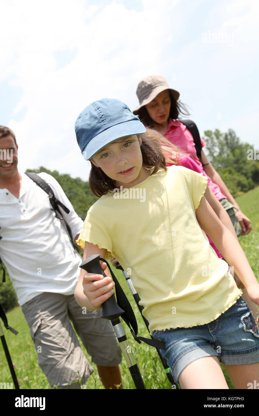 Family rambling in country field - Stock Image