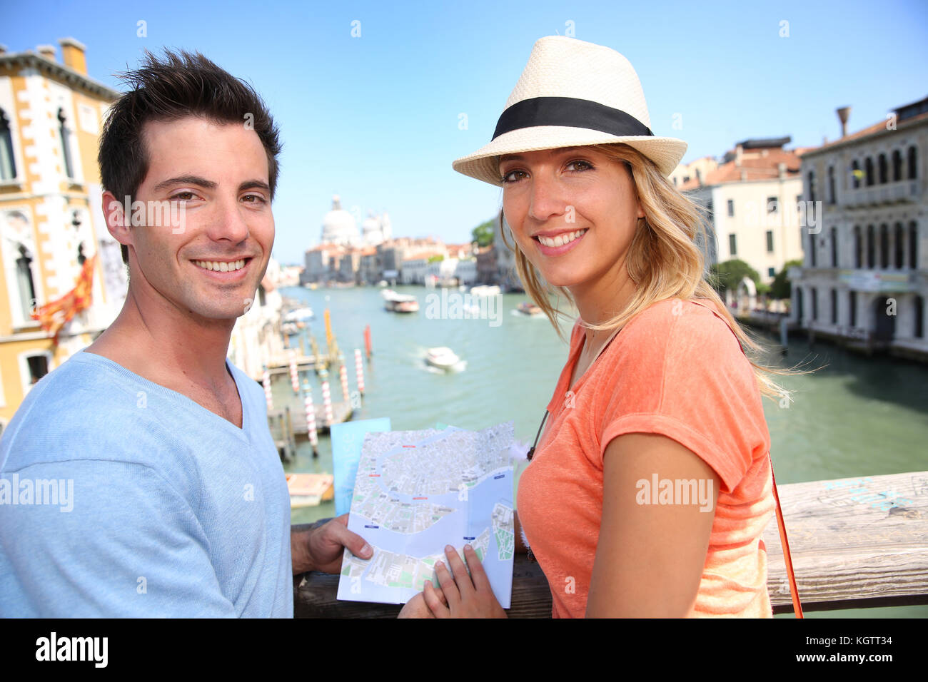 Couplelooking at map on the Academia Bridge in Venice, Italy - Stock Image