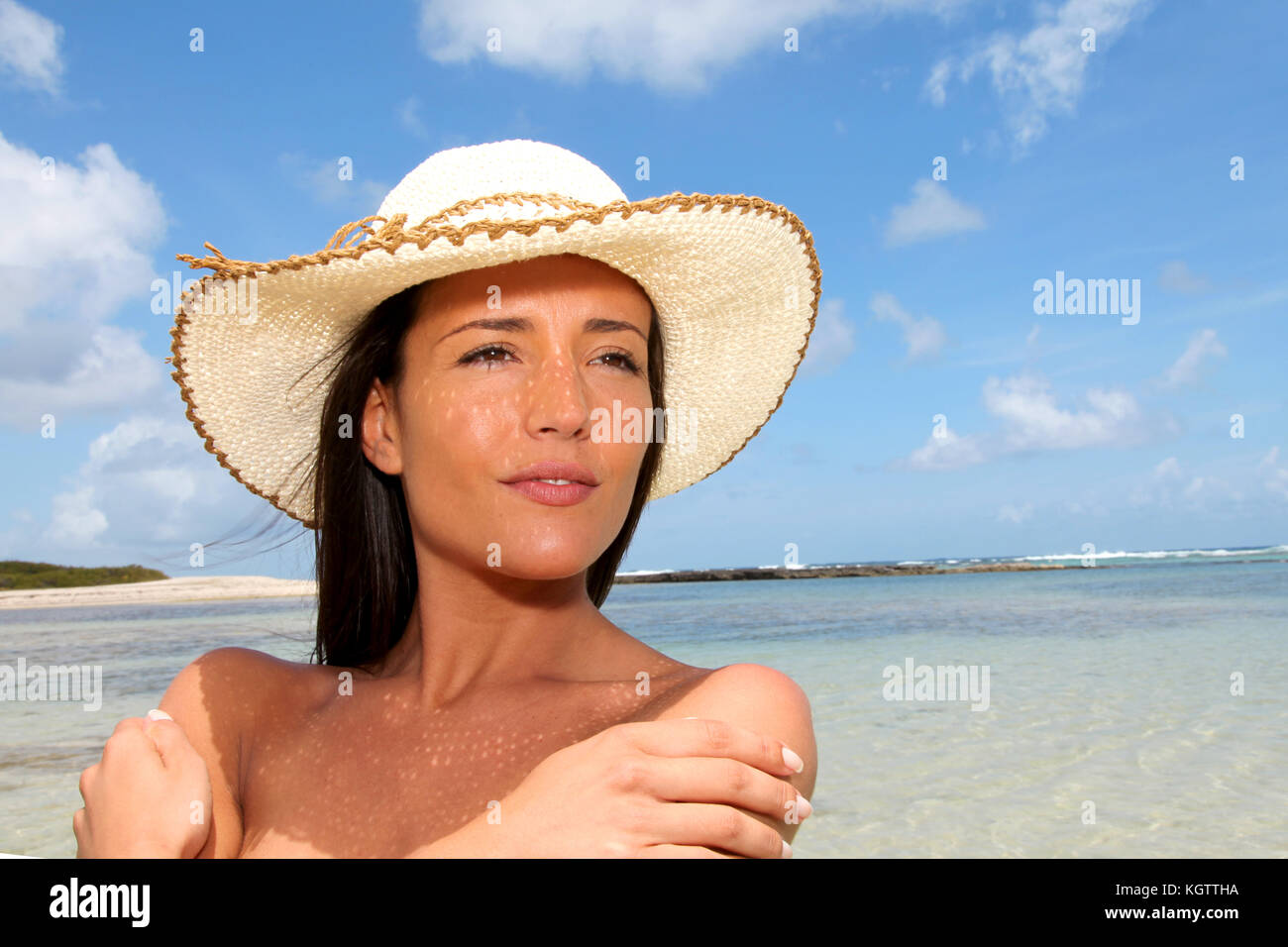 97c225ffdb903 Closeup of attractive woman wearing hat at the beach Stock Photo ...