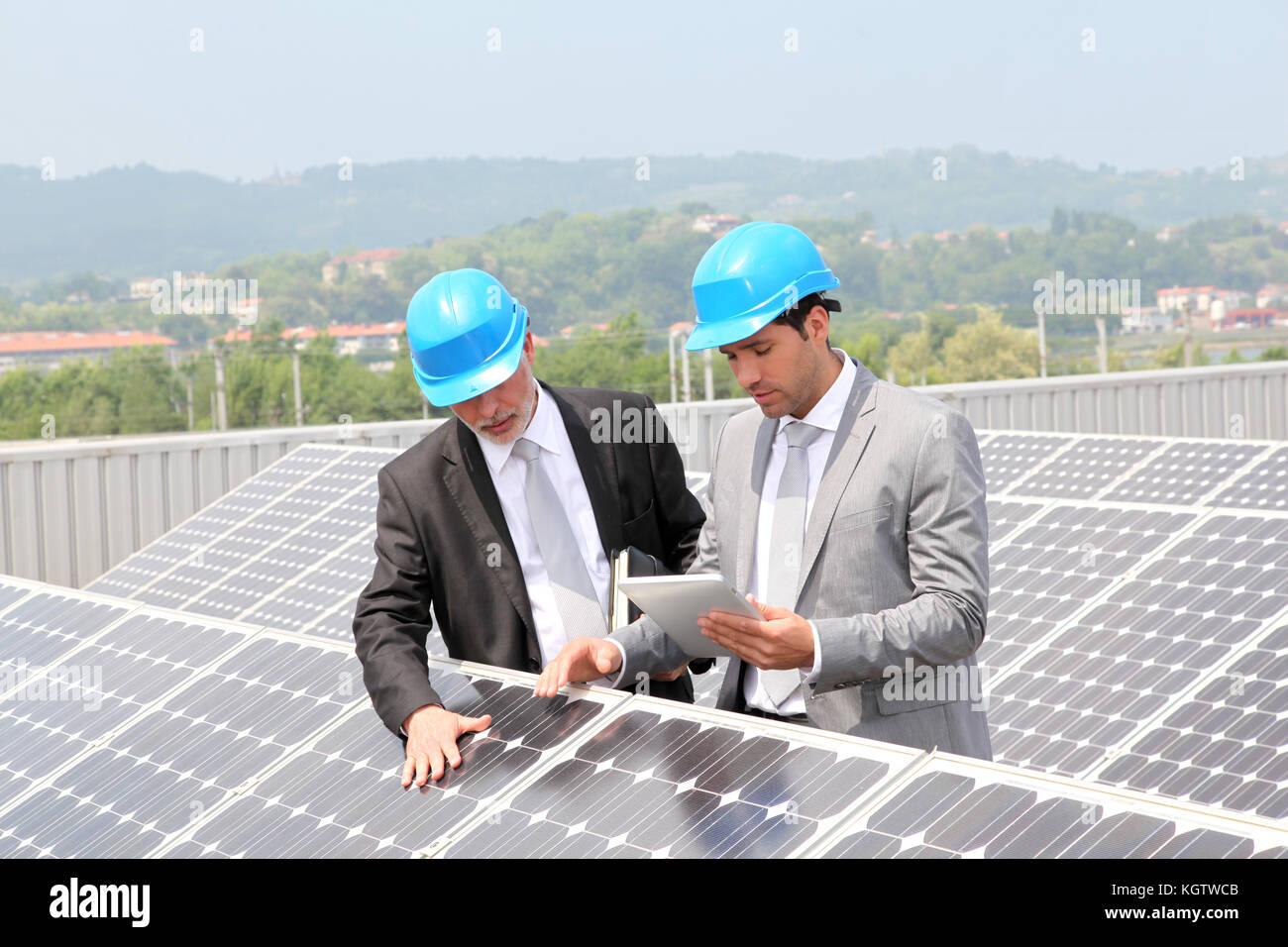 Engineers checking solar panels setup - Stock Image