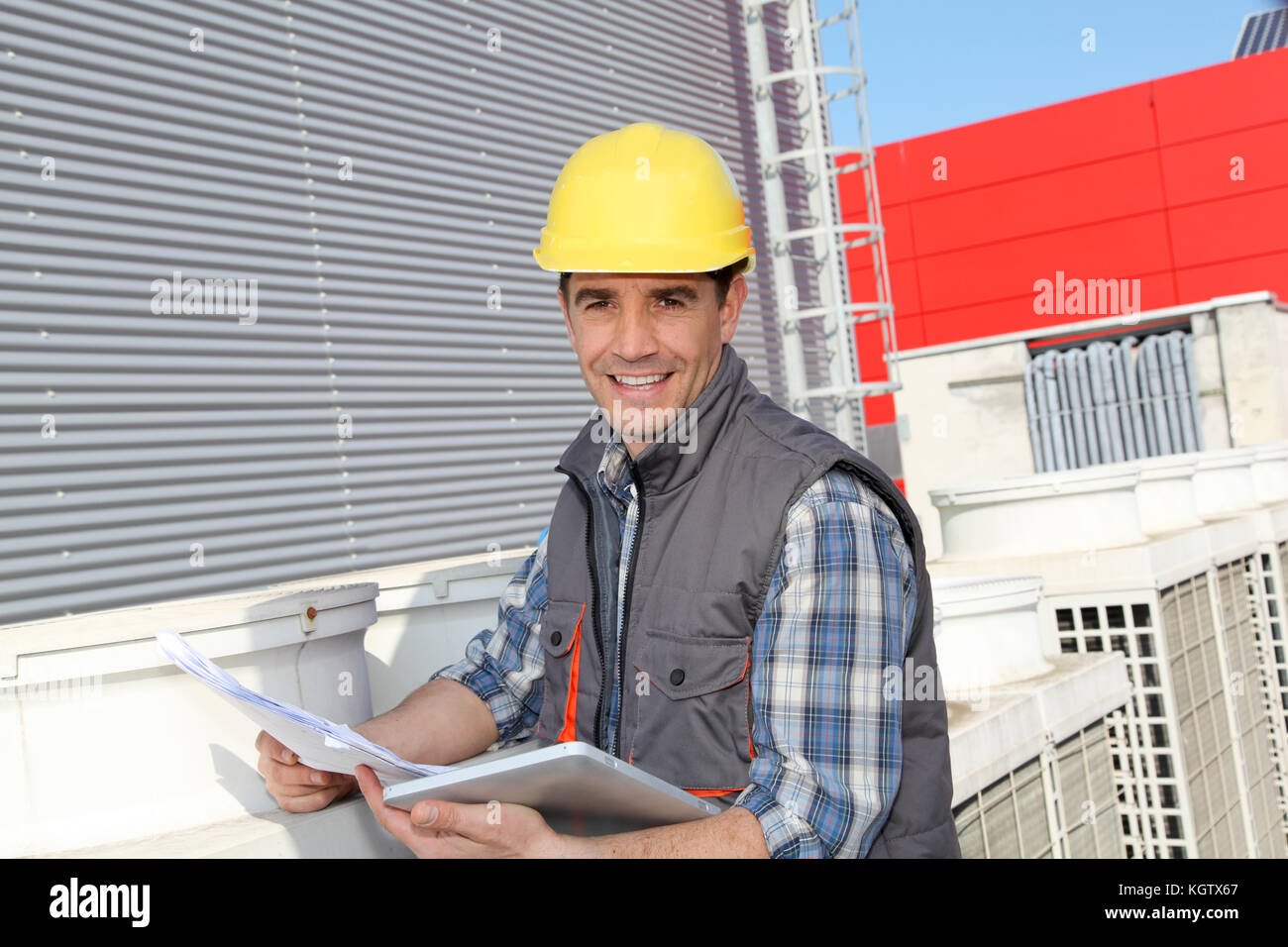 Foreman on industrial site with tablet - Stock Image