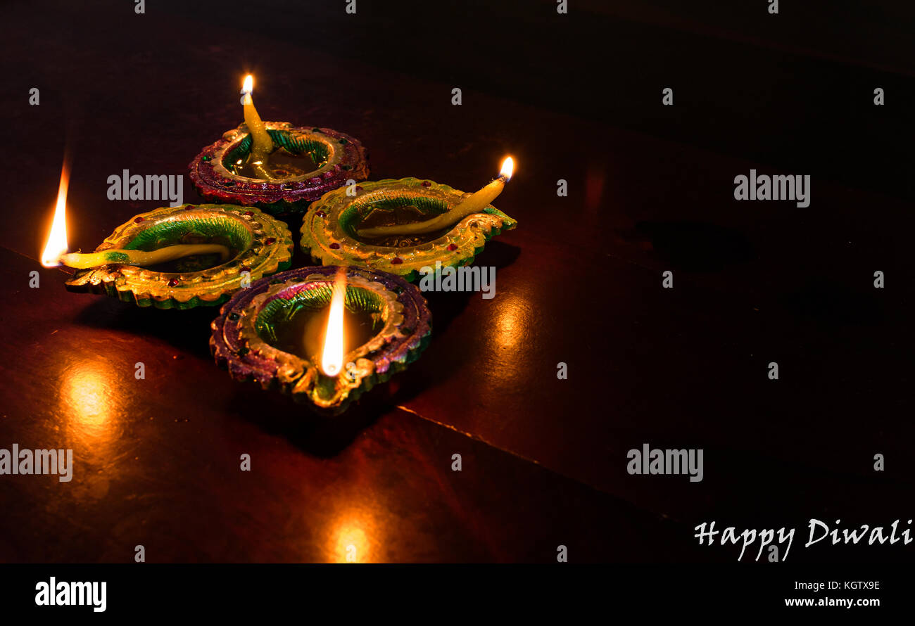 Diwali greeting card stock photos diwali greeting card stock diwali decorations with traditional indian oil lamps with selective focus on a wooden table both m4hsunfo