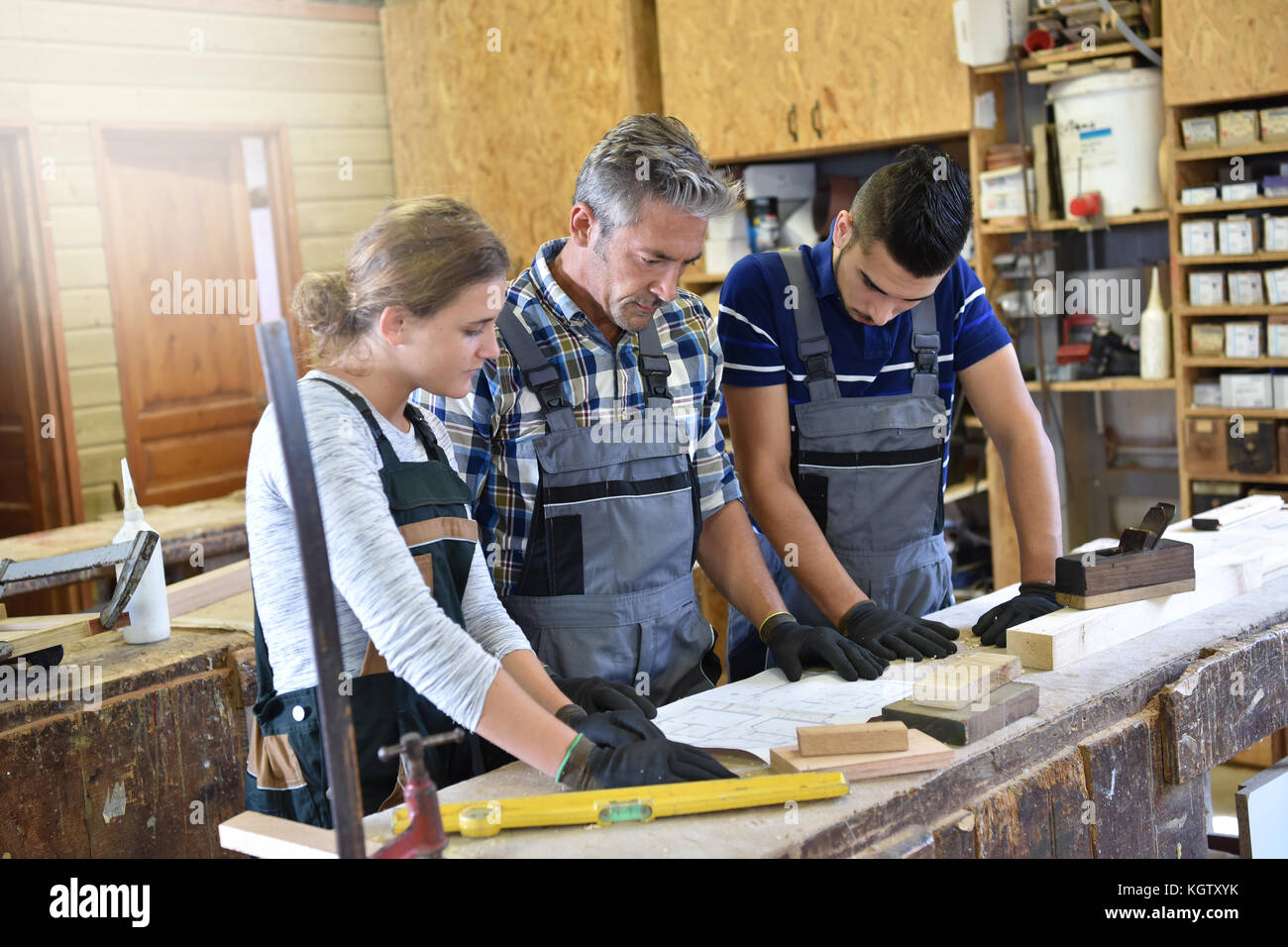 Group of students in woodwork training course - Stock Image