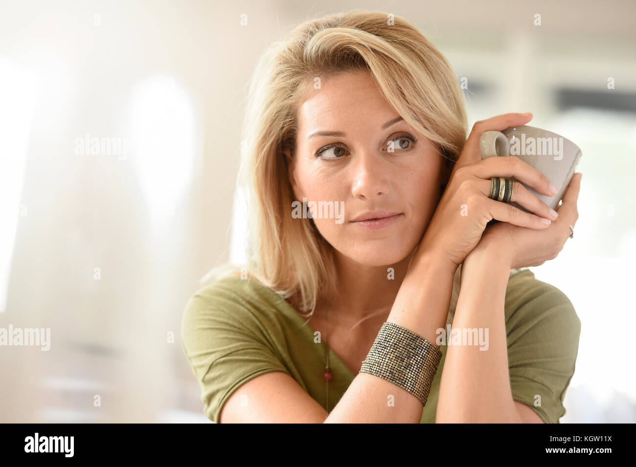Blond hot women Attractive Blond Middle Aged Woman Dinking Hot Tea Stock Photo Alamy
