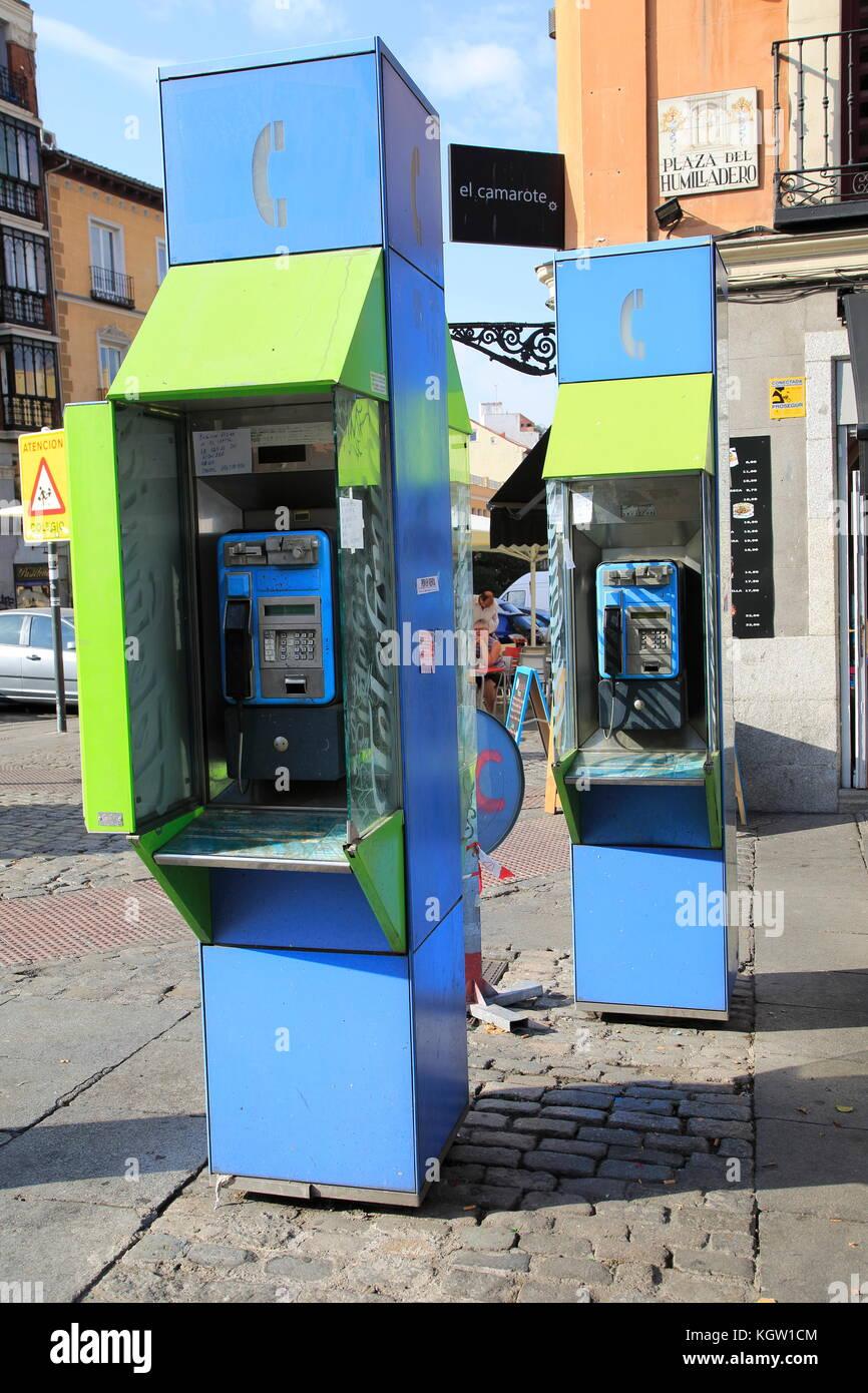Telephone kiosk boxes in street, La Latina, Madrid city centre, Spain - Stock Image