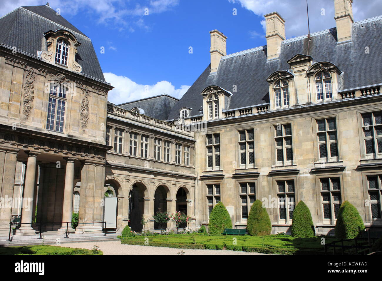 PARIS, FRANCE - MAY 24, 2015: Courtyard with the beautiful gardens of Carnavalet Museum. The museum was opened in - Stock Image