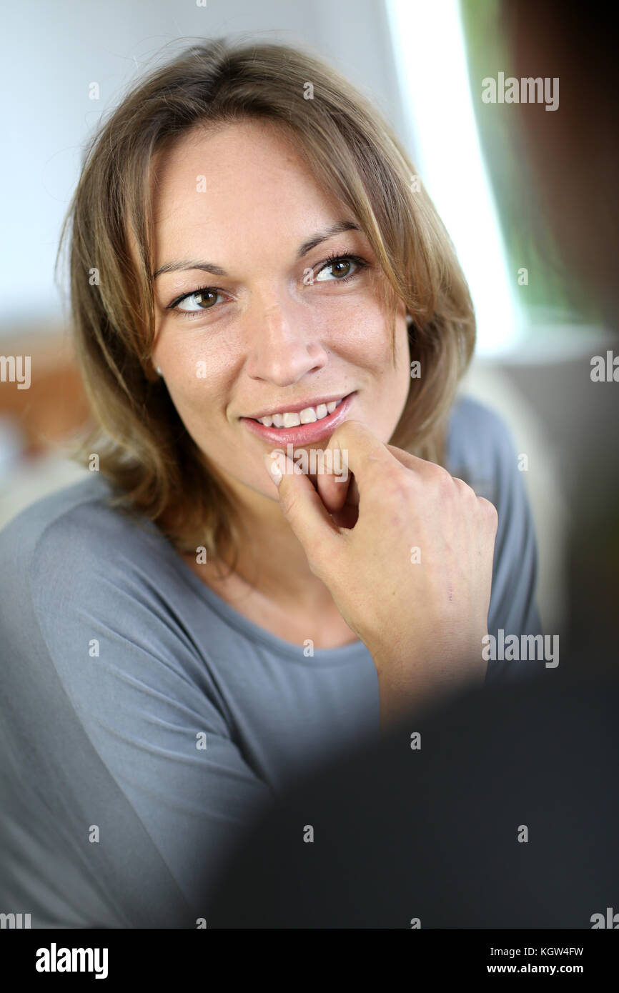Closeup of woman listening carefully to other person Stock Photo
