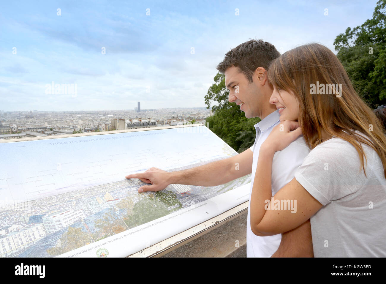 Couple in Paris looking at the city view from Montmartre - Stock Image