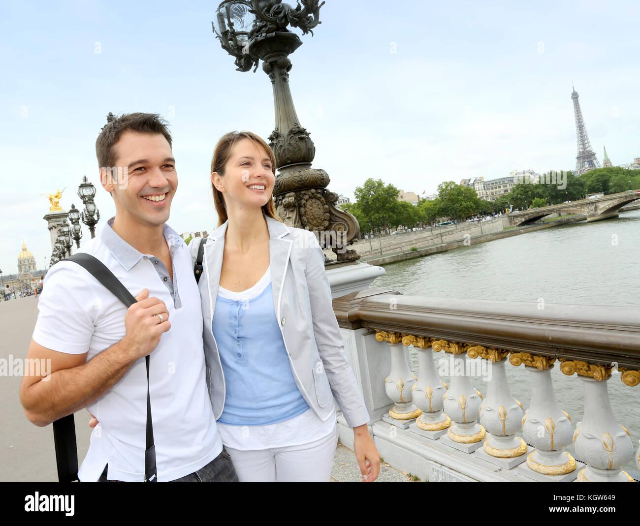 Couple in Paris walking on the bridge Alexander the Third - Stock Image