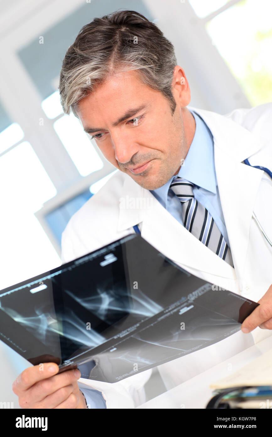 Man looking at Xray results - Stock Image