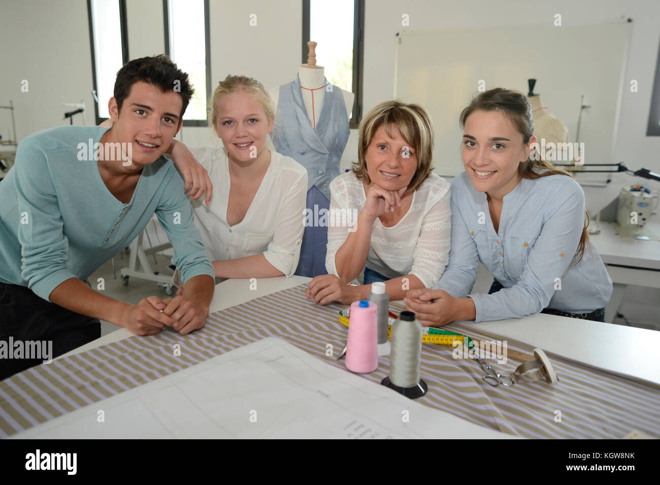 Portrait of group of students with teacher - Stock Image