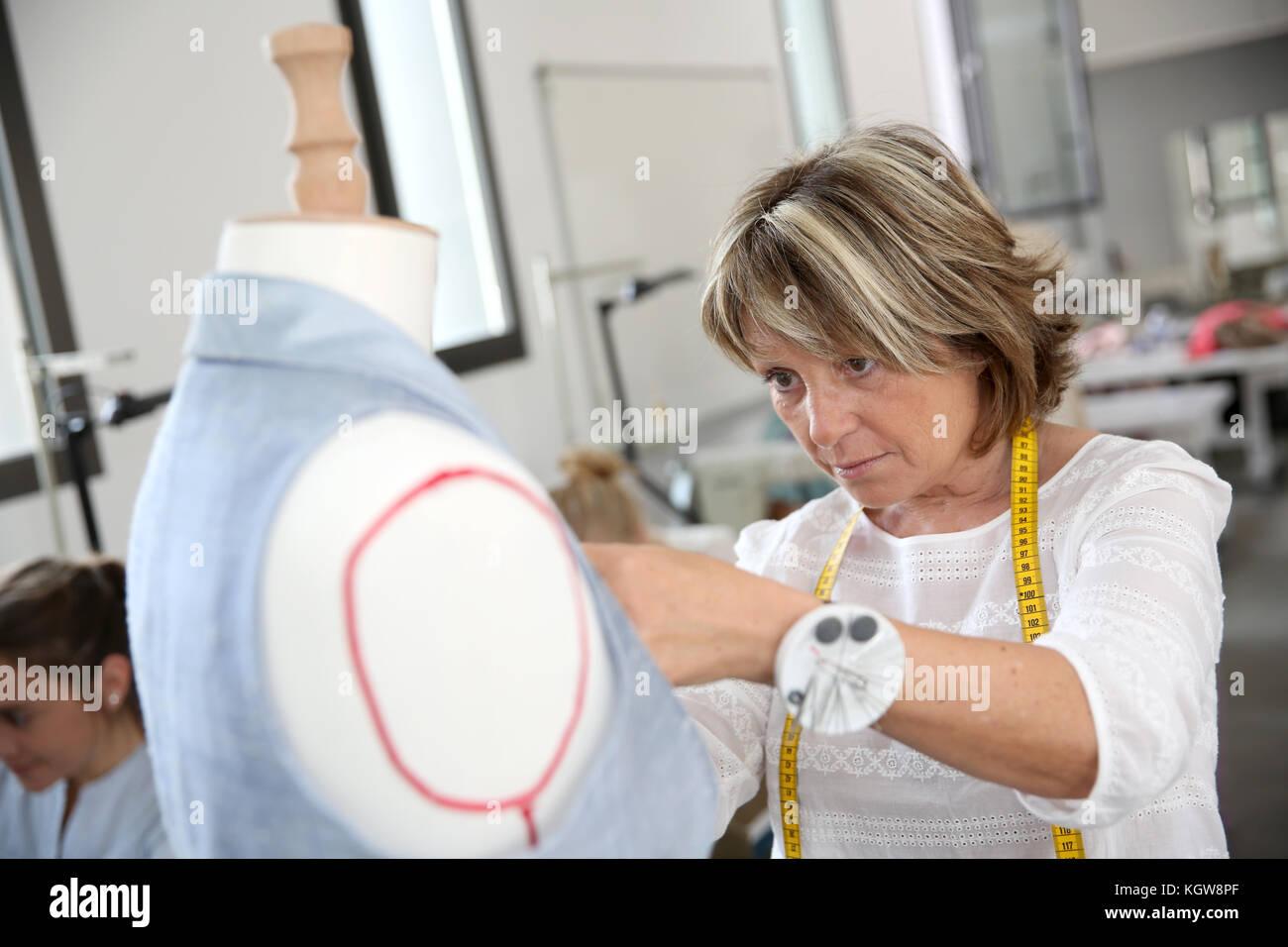 Closeup of dressmaker in training class - Stock Image