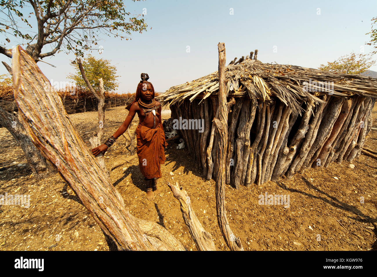 Himba woman in his village near Epupa Falls. Himbas also lived also in south Angola, where they are called hereros. - Stock Image